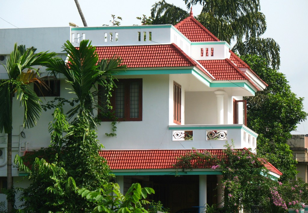 Kerala houses modern building design for Kerala homes photo gallery